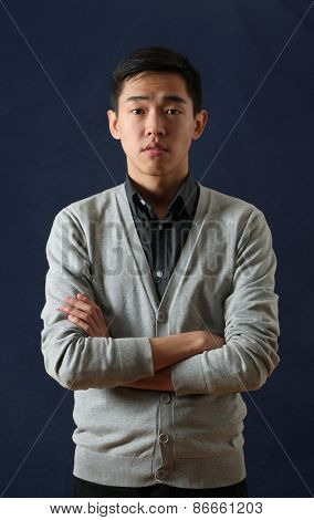 Young Asian man looking at camera