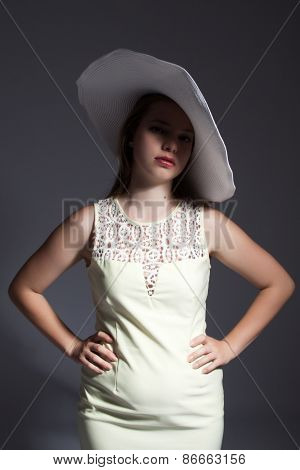 Young Lady In White Hat