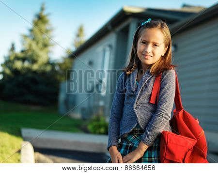 little girl with backpack ready for school