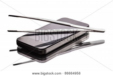 Mobile Phone And Tweezers