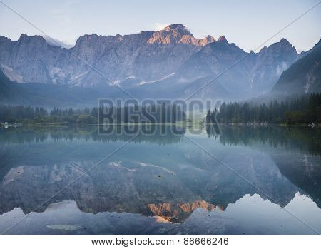 Alpine lake,Sunrise over the alpine lake Laghi di Fusine