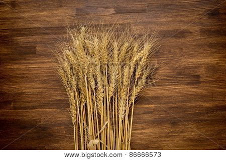 wheat on wooden background.