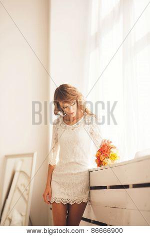 Girl Standing Near A Window