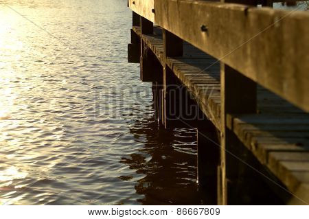 Bridge over sunlit lake
