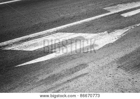 Road Marking With Tire Tracks On Asphalt