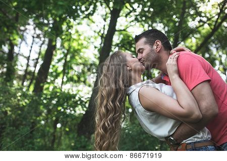 Cute Couple In A Forest
