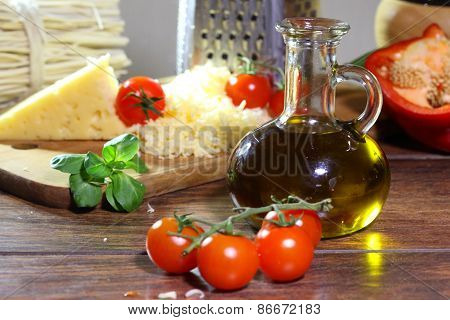 Cheese Grated, Tomatoes And A Jug With Olive Oil