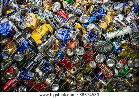 Different Cans For Recycling Into A Container