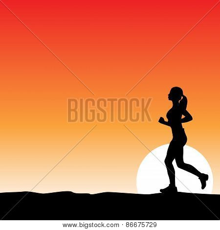 Girl jogging at sunset
