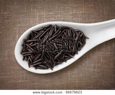 Black Rice In White Porcelain Spoon / High-res Photo Of Grain In White Porcelain Spoon On Burlap