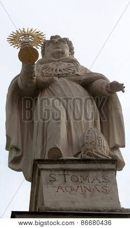 VIENNA, AUSTRIA - OCTOBER 10: Saint Thomas Aquinas on the facade of Dominican Church in Vienna, Austria on October 10, 2014. Famous baroque church was completed in 1634.