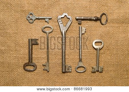 Seven Very Old Keys  On Old Cloth