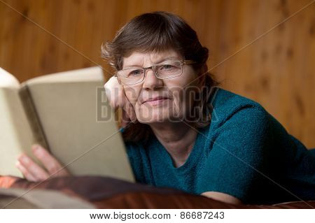 Cute Senior Woman Absorbed In Reading