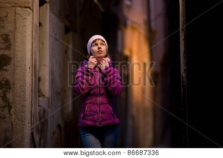 Girl On The Walk On The Street At Night