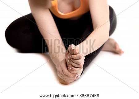 Female Athlete Holding Sore Foot, Close Up Of Female Legs