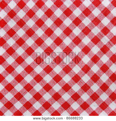 Red and white checkered fabric texture.