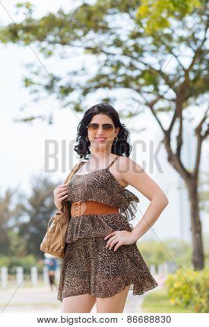 Woman in short leopard dress