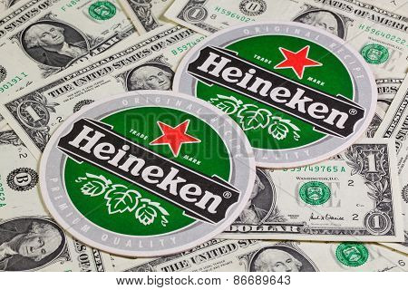 Beermat From Heineken Beer And Us Dollars.