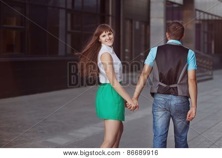 happy young couple in city
