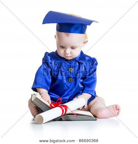Portrait of cute baby in academic hat with book