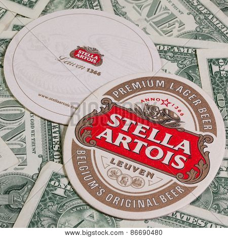 Beermats From Stella Artois And Us Dollars.