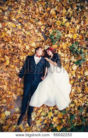 Autumn wedding photo of bride and groom