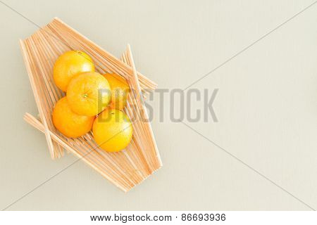 Fresh Oranges On Wooden Tray At The Table