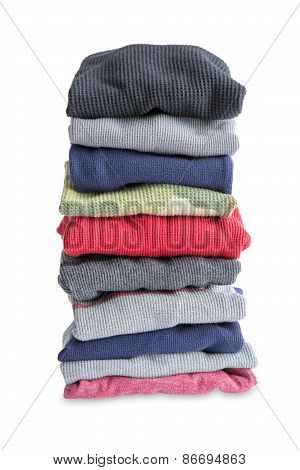 Folded Newly Washed Clothes On White Background