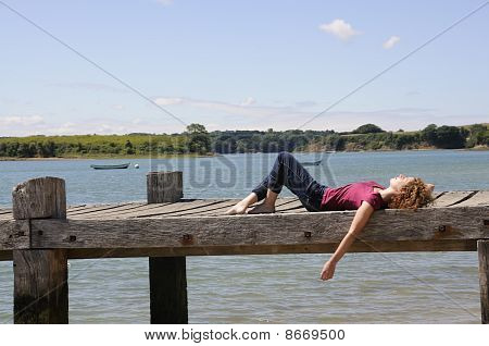 Girl Relaxing At Landing Stage In France