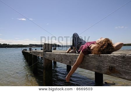 Girl Relaxing On Landing Stage