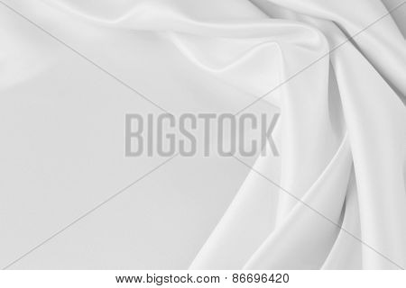 Closeup of rippled white satin silk fabric