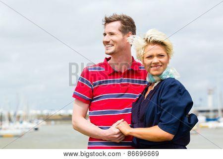 Couple enjoying vacation at German north sea ship pier