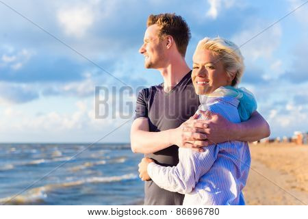 Couple enjoying romantic sunset at German north sea beach