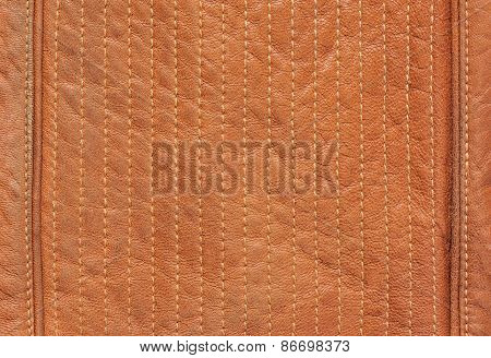 Series of stitches on the brown natural leather