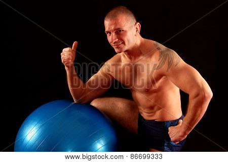 Man With Pilates Ball Shows Okay
