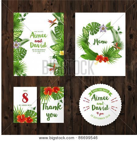 wedding invitation cards with tropical plants and flowers