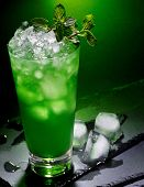 image of mint-green  - Green drink  with cube ice and mint leaf on dark background - JPG