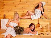 foto of sauna woman  - Group women relaxing in sauna - JPG