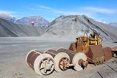 pic of ferrous metal  - Industrial Tools various and hill ferrous for metal foundry the background the Alps - JPG