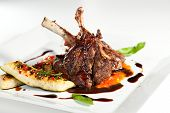 picture of lamb  - Roasted Lamb Chops on Tomato Sauce Garnished with Vegetables and Basil - JPG