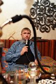 picture of shisha  - Man smoking nargile in the asian restaurant - JPG