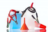stock photo of rectifier  - windshield washer fluids and jump start cables - JPG