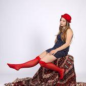 image of garter  - Young woman in red hat in garters - JPG