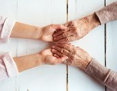 stock photo of granddaughters  - Unrecognizable grandmother and her granddaughter holding hands - JPG