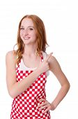 foto of pinafore  - Young cook female pointing isolated on white - JPG