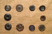 pic of hasp  - A lot of old buttons scattered on the old cloth - JPG