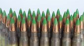 pic of cartridge  - Rifle cartridges with bullets that have a green tip on a white background  - JPG