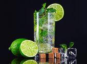 stock photo of mojito  - Mojito cocktail over black background - JPG