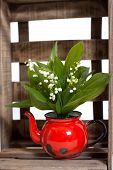 picture of wooden crate  - Lilies of the valley in a wooden crate - JPG