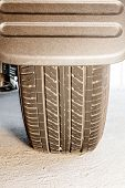 stock photo of truck-stop  - tire and mudguard in closeup of a car that stopped - JPG